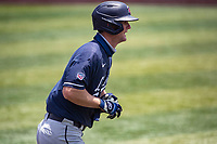 Liberty Flames left fielder Aaron Anderson (9) makes his way to first base against the Duke Blue Devils in NCAA Regional play on Robert M. Lindsay Field at Lindsey Nelson Stadium on June 4, 2021, in Knoxville, Tennessee. (Danny Parker/Four Seam Images)