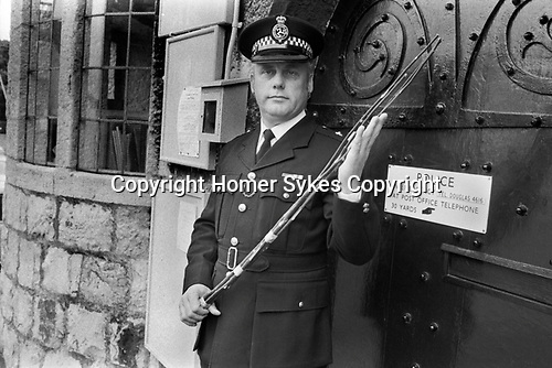 The birch was still used for corporal punishment on the Isle of Man during the 1970s. Administered by the police to petty offenders.<br /> <br /> Castletown. The European Court of Human Rights condemned the practice of corporal punishment using birch branches. Superintendent Alan Killip, the Isle of Man's highest ranking police officer holding a birch at Castle Rushen. A police officer administers corporal punishment to offenders. The vast majority of the population of the Isle of Man voted to maintain this form of punishment.
