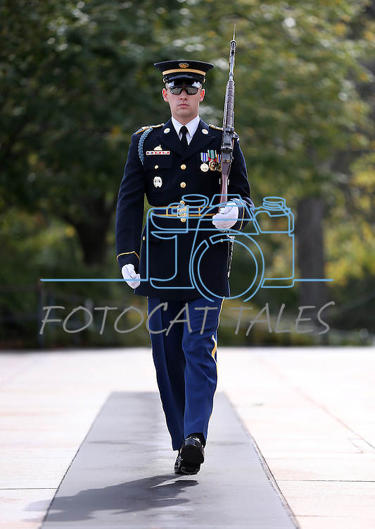 A U.S. Army soldier walks the mat at the Tomb of the Unknown Soldier at the Arlington National Cemetery, in Arlington, Vir., on Sunday, Nov. 3, 2014.<br /> Photo by Cathleen Allison