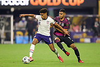 LAS VEGAS, NV - AUGUST 1: Nicholas Gioacchini #8 of the United States is marked by Gilberto Sepulveda #19 of Mexico during a game between Mexico and USMNT at Allegiant Stadium on August 1, 2021 in Las Vegas, Nevada.
