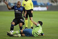 SAN JOSE, CA - OCTOBER 18: Nicolas Lodeiro #10 of the Seattle Sounders goes for a tackle on Judson #93 of the San Jose Earthquakes during a game between Seattle Sounders FC and San Jose Earthquakes at Earthquakes Stadium on October 18, 2020 in San Jose, California.