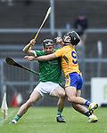 Mike Mackey of Limerick in action against Kieran Galvin of Clare during their Munster U-21 hurling quarter final at Cusack park. Photograph by John Kelly.