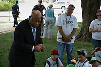 """May 24, 2011 (Washington, DC) Congressman John Lewis (D-GA) talked to a group of Texas students from the KIPP 3D Academy.  He showed the students large photographs of his activity in the civil rights struggle, and talked about knowing Dr. Martin Luther King, Jr.  """"Dr. King was a loving and compassionate man"""" he told the students.  Lewis also talked about appearing on Oprah with the original """"Freedom Riders"""", and said that """"things have changed from the times when white only signs were in the bus stationas"""". (Photo: Don Baxter/Media Images International).."""