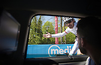 """Fabian Cancellara (SUI/Trek-Segafredo) checks in at the team car during the recon of the prologue telling his mechanic Roger Teel """"It will be like riding into an arena this afternoon."""" <br /> <br /> stage 1: Apeldoorn prologue 9.8km<br /> 99th Giro d'Italia 2016"""