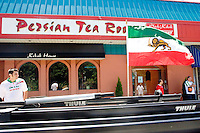 Fans of Iran gather outside of the Persian Tea Room, a restaurant in the New York City area, before the start of the Iran-Mexico match on June 11, 2006.<br /> <br /> The World Cup, held every four years in different locales, is the world's pre-eminent sports tournament in the world's most popular sport, soccer (or football, as most of the world calls it).  Qualification for the World Cup is open to any country with a national team accredited by FIFA, world soccer's governing body. The first World Cup, organized by FIFA in response to the popularity of the first Olympic Games' soccer tournaments, was held in 1930 in Uruguay and was participated in by 13 nations.    <br /> <br /> As of 2010 there are 208 such teams.  The final field of the World Cup is narrowed down to 32 national teams in the three years preceding the tournament, with each region of the world allotted a specific number of spots.  <br /> <br /> The World Cup is the most widely regularly watched event in the world, with soccer teams being a source of national pride.  In most nations, the whole country is at a standstill when their team is playing in the tournament, everyone's eyes glued to their televisions or their ears to the radio, to see if their team will prevail.  While the United States in general is a conspicuous exception to the grip of World Cup fever there is one city that is a rather large exception to that rule.  In New York City, the most diverse city in a nation of immigrants, the melting pot that is America is on full display as fans of all nations gather in all possible venues to watch their teams and celebrate where they have come from.