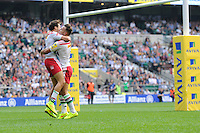 Ollie Lindsay-Hague of Harlequins celebrates scoring a try with team mate Danny Care of Harlequins during the Premiership Rugby Round 1 match between London Irish and Harlequins at Twickenham Stadium on Saturday 6th September 2014 (Photo by Rob Munro)
