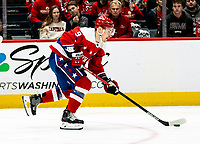 WASHINGTON, DC - JANUARY 31: Dmitry Orlov #9 of the Washington Capitals  moves up ice during a game between New York Islanders and Washington Capitals at Capital One Arena on January 31, 2020 in Washington, DC.