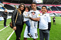 Wayne Routledge of Swansea City at full time with family during the Sky Bet Championship match between Swansea City and Hull City at the Liberty Stadium in Swansea, Wales, UK. Saturday 27 April 2019