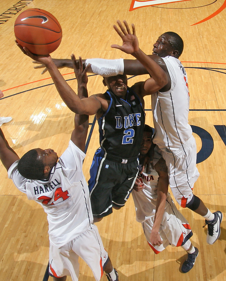 Feb. 16, 2011; Charlottesville, VA, USA; Duke Blue Devils guard Nolan Smith (2) is wrapped between Virginia Cavaliers defenders Virginia Cavaliers guard K.T. Harrell (24), Virginia Cavaliers guard Mustapha Farrakhan (2) and Virginia Cavaliers center Assane Sene (5) during the second half of the game at the John Paul Jones Arena. The Duke Blue Devils won 56-41. Credit Image: © Andrew Shurtleff