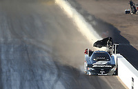 Feb. 23, 2013; Chandler, AZ, USA; NHRA funny car driver Cruz Pedregon hits the wall during qualifying for the Arizona Nationals at Firebird International Raceway. Mandatory Credit: Mark J. Rebilas-