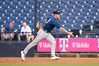 Lakeland Flying Tigers first baseman Jimmy Kerr (8) flips the ball to the pitcher covering the bag during a game against the Tampa Tarpons on July 15, 2021 at George M. Steinbrenner Field in Tampa, Florida.  (Mike Janes/Four Seam Images)