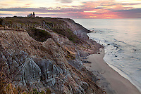 The pink sun rises over Mohegan Bluffs, casting shadow over Block Island's Southeast Light.