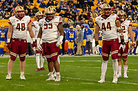 Boston College defensive linemen Tanner Karafa (48), TJ Rayam (99) and Brandon Barlow (44) look for sideline signals. The Boston College Eagles defeated the Pitt Panthers 26-19 in the football game played at Heinz Field, Pittsburgh Pennsylvania on November 30, 2019.