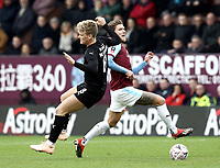 Barnsley's Cameron McGeehan vies for possession with Burnley's Jeff Hendrick<br /> <br /> Photographer Rich Linley/CameraSport<br /> <br /> Emirates FA Cup Third Round - Burnley v Barnsley - Saturday 5th January 2019 - Turf Moor - Burnley<br />  <br /> World Copyright © 2019 CameraSport. All rights reserved. 43 Linden Ave. Countesthorpe. Leicester. England. LE8 5PG - Tel: +44 (0) 116 277 4147 - admin@camerasport.com - www.camerasport.com