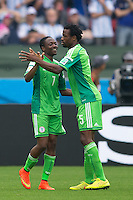 Ahmed Musa of Nigeria celebrates scoring a goal with team mate Efe Ambrose after making it 1-1