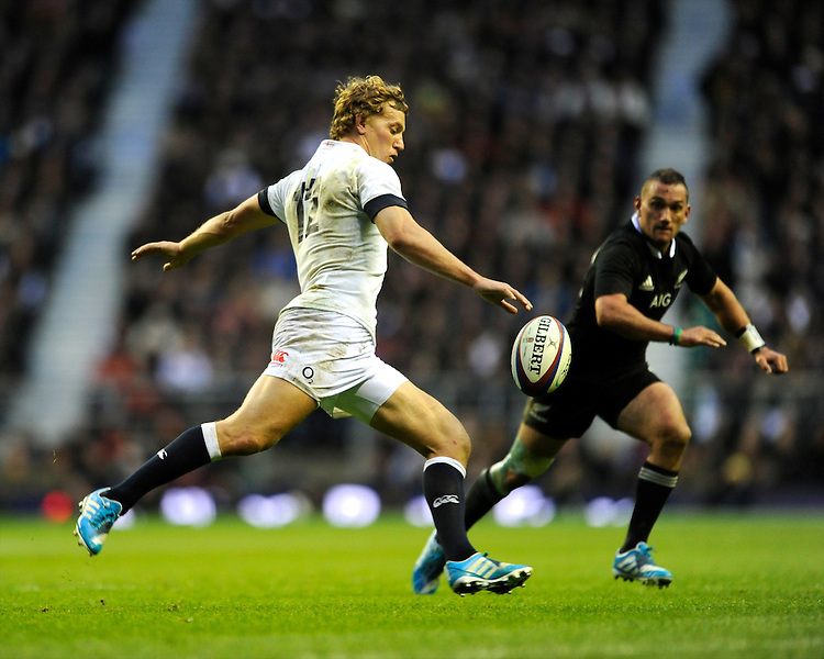 Billy Twelvetrees of England clears his line ahead of Aaron Cruden of New Zealand during the QBE Autumn International match between England and New Zealand at Twickenham on Saturday 16th November 2013 (Photo by Rob Munro)