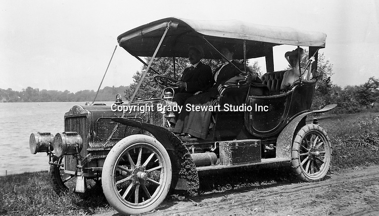 Southwestern Ohio:  Brady Stewart and members of the Brady family driving along the Ohio River in the new Buick Model F.