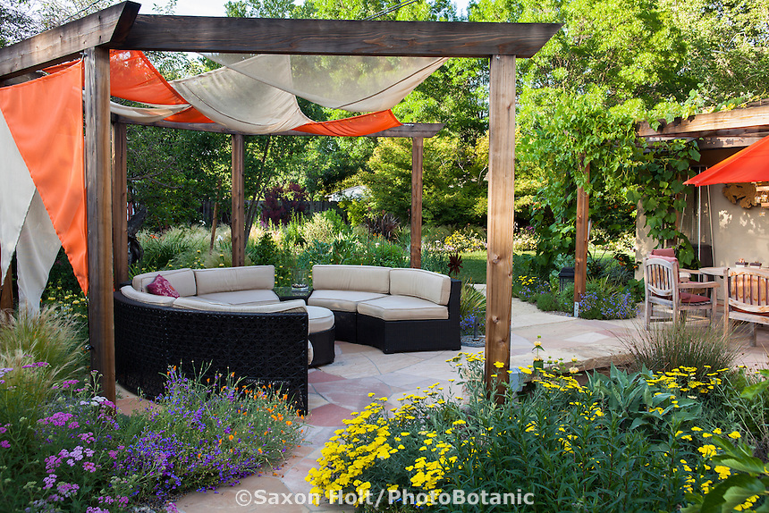 Colorful fabric covering gazebo ramada with wicker patio furniture in Habets garden, Pleasant Hill