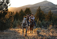 A family trail rides in central Oregon at sunset through high range. <br />