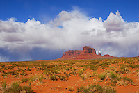 """""""MONUMENT""""<br /> <br /> Out of the desert floor a desert monument, crowned by billowy white clouds, thrusts up into the deep blue sky. This is Navajo country at Monument Valley Arizona"""