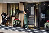A doorman in uniform outside the Dorchester Hotel in Park Lane, London.
