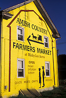 AJ3002, amish, mural, Lancaster County, Pennsylvania, Yellow painted mural on side of a building advertsing the Amish Country Farmers Market in Pennsylvania Dutch Country in the state of Pennsylvania.