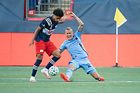 FOXBOROUGH, MA - SEPTEMBER 19: Tajon Buchanan #17 of New England Revolution and Gudmundur Thorarinsson #20 of New York City FC compete for the ball during a game between New York City FC and New England Revolution at Gillette on September 19, 2020 in Foxborough, Massachusetts.