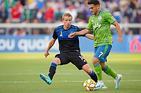 SAN JOSE, CA - SEPTEMBER 30: Jackson Yueill #14 of the San Jose Earthquakes marks Cristian Roldan #7 of the Seattle Sounders FC during a Major League Soccer (MLS) match between the San Jose Earthquakes and the Seattle Sounders on September 30, 2019 at Avaya Stadium in San Jose, California.