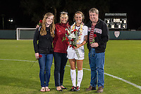STANFORD, CA - October 21, 2012: Madeleine Thompson with her family during the Senior Day celebration after the Stanford vs Washington women's soccer match in Stanford, California.  Stanford won 3-0.