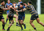 Trent Bishop of Howick is tackled.  Fox Memorial Rugby League, Northcote Tigers v Howick Hornets, Birkenhead War Memorial Park Auckland, Saturday 22nd July 2017. Photo: Simon Watts / www.bwmedia.co.nz