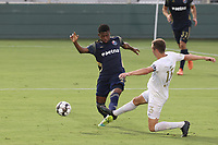 CARY, NC - AUGUST 01: Dre Fortune #8 is kicked in the ankle by Jake Rufe #13 while attempting to block a pass during a game between Birmingham Legion FC and North Carolina FC at Sahlen's Stadium at WakeMed Soccer Park on August 01, 2020 in Cary, North Carolina.