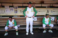 OAKLAND, CA - JUNE 27:  Coach Mike Gallego #2, manager Bob Melvin #6, and coach Mike Aldrete #14 of the Oakland Athletics wait in the dugout before the game against the Kansas City Royals at O.co Coliseum on Saturday, June 27, 2015 in Oakland, California. Photo by Brad Mangin