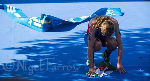 01 JUN 2013 - MADRID, ESP - Non Stanford (GBR) of Great Britain recovers after winning the elite women's ITU 2013 World Triathlon Series round in Casa de Campo, Madrid, Spain <br /> (PHOTO (C) 2013 NIGEL FARROW)