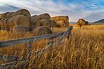 Gallatin County, MT: Evening light rakes across stacked hay bales