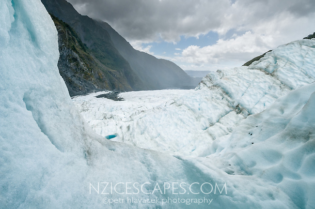 View from blue ice cave on Franz Josef Glacier in moody weather, Westland Tai Poutini National Park, UNESCO World Heritage Area, West Coast, New Zealand, NZ