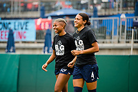 TACOMA, WA - JULY 31: Alana Cook #4 and Tziarra King #23 of the OL Reign enter the pitch for warm ups before a game between Racing Louisville FC and OL Reign at Cheney Stadium on July 31, 2021 in Tacoma, Washington.