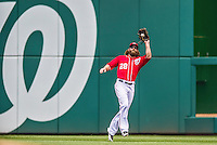 22 June 2014: Washington Nationals outfielder Jayson Werth pulls in a Andrelton Simmons fly in the 3rd inning against the Atlanta Braves at Nationals Park in Washington, DC. The Nationals defeated the Braves 4-1 to split their 4-game series and take sole possession of first place in the NL East. Mandatory Credit: Ed Wolfstein Photo *** RAW (NEF) Image File Available ***