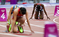05 AUG 2012 - LONDON, GBR - Perri Shakes-Drayton (GBR) (right) of Great Britain waits for the start of her women's 400m hurdles round 1 heat during the London 2012 Olympic Games athletics in the Olympic Stadium at the Olympic Park in Stratford, London, Great Britain .(PHOTO (C) 2012 NIGEL FARROW)