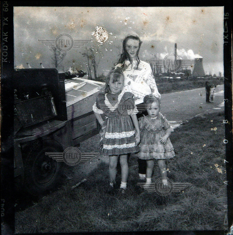 A portrait of a group of Irish Traveller children taken from an old contact sheet.