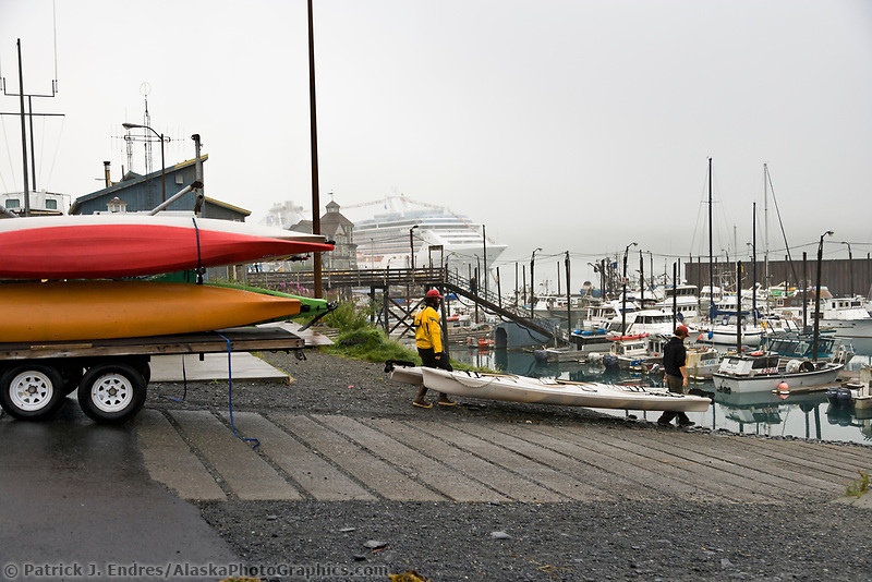 Unloading sea kayaks in the Whittier boat harbor, Whittier, Alaska.