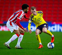 21st November 2020; Bet365 Stadium, Stoke, Staffordshire, England; English Football League Championship Football, Stoke City versus Huddersfield Town; Hogg under pressure from Jordan Cousins of Stoke City