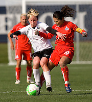 Homare Sawa of the Washington Freedom fights for the ball with Joanna Lohman of the Philadelphia Independence during their preseason game at the Maryland SoccerPlex in Germantown, Maryland.