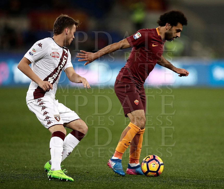 Calcio, Serie A: Roma, stadio Olimpico, 19 febbraio 2017.<br /> Roma's Mohamed Salah (r) in action with Torino's Adem Ljajic (l) during the Italian Serie A football match between As Roma and Torino at Rome's Olympic stadium, on February 19, 2017.<br /> UPDATE IMAGES PRESS/Isabella Bonotto
