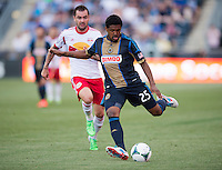 Sheanon Williams (25) of the Philadelphia Union passes the ball back to the keeper during a Major League Soccer game at PPL Park in Chester, PA.  Philadelphia defeated New York, 3-0.