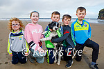 Enjoying a stroll on the beach in Ballybunion on Friday, l to r: Fionn, Emma Rose and Eoghan Óg Galvin, Seanie, Darragh Kissane with Lucky the dog .