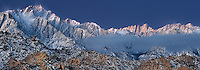 902000025 panoramic view winter sunrise with snow covered granite boulders in the bureau of land management protected land the alabama hills in the southern section of the eastern sierras with lone pine peak mount whitney and mount russell in the background in kern county california