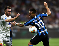 Calcio, Serie A: Inter Milano - Lecce, Giuseppe Meazza stadium, September 26 agosto 2019.<br /> Inter's Lautaro Martinez (r) in action with Lecce's Fabio Lucioni (l) during the Italian Serie A football match between Inter and Lecce at Giuseppe Meazza (San Siro) stadium, September August 26,, 2019.<br /> UPDATE IMAGES PRESS/Isabella Bonotto