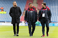 (L-R) Swansea manager Carlos Carvalhal and colleagues inspect the pitch prior to the game during the Premier League match between Huddersfield Town and Swansea City and at the John Smith's Stadium Huddersfield, England, UK. Saturday 10 March 2018