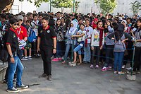 Yogyakarta, Java, Indonesia.  Student Tourists Waiting for Entry into the Sultan's Palace.