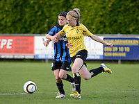 20140502 - VARSENARE , BELGIUM : Brugge's Amber De Priester (left) pictured with Lierse's Merel Groenen (right) during the soccer match between the women teams of Club Brugge Vrouwen  and WD Lierse SK  , on the 26th matchday of the BeNeleague competition on Friday 2 May 2014 in Varsenare .  PHOTO DAVID CATRY